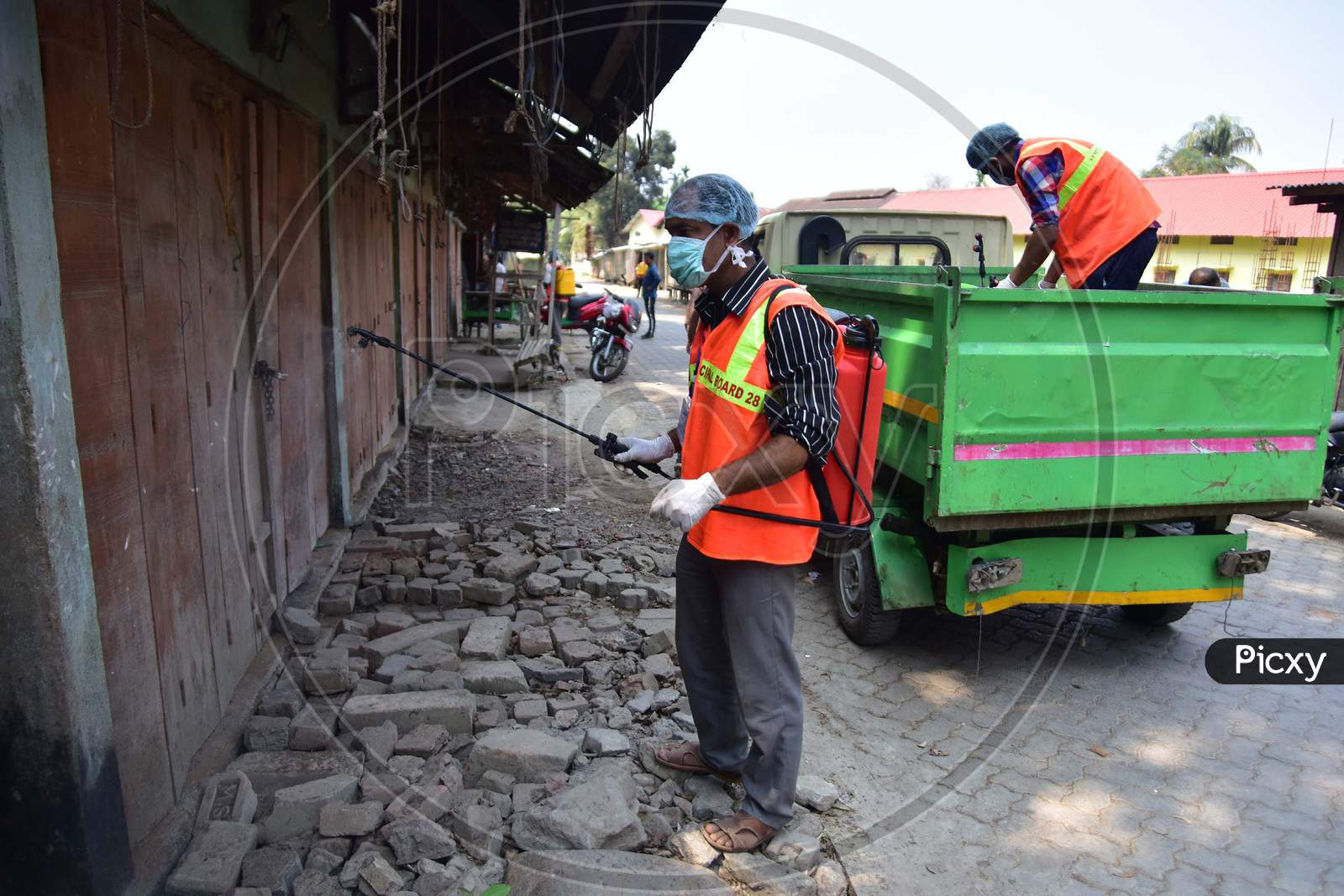 A Municipality Worker Spray Disinfectant During India Government-Imposed Lockdown As A Preventive Measure Against The Covid-19 Coronavirus In Nagaon District Of Assam,India