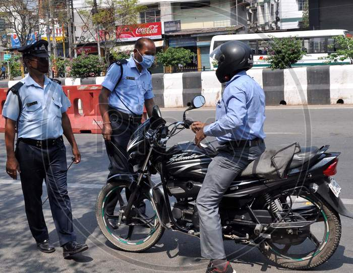 Police Personnel Question Commuters Who Defied Curfew During A 21-Day Nationwide Lockdown, In The Wake Of Coronavirus Pandemic, In Guwahati  On  Wednesday, March 25, 2020