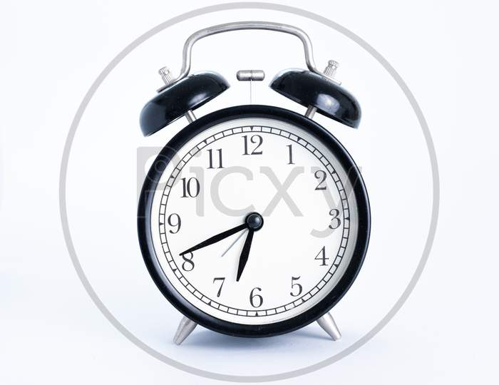 Classic Black Table Clock Isolated On A White Background. Alarm Clock With Copy Space.