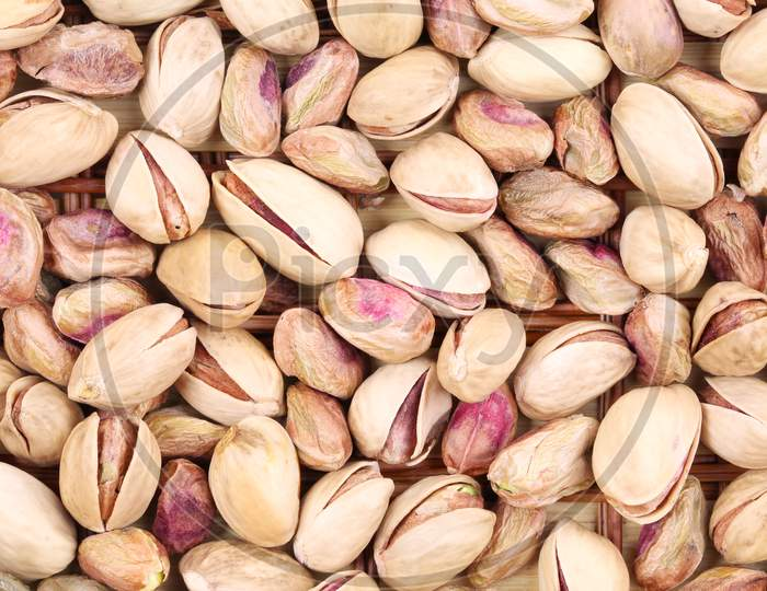 Close Up Of Many Pistachios. Whole Background.