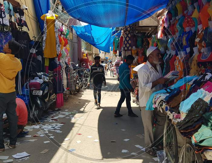Bengaluru, Karnataka / India - November 19 2019: People walking down the streets on Shivaji nagar in the noon time shopping for dress and fancy items