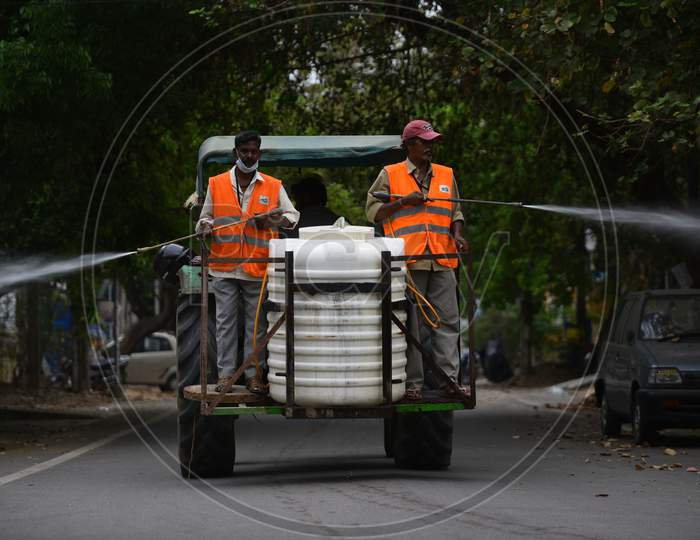 Disinfectant (Sodium Hypochlorite) being sprayed in streets by GHMC Sanitation workers using motors fixed to tractors to prevent the spread of coronavirus, covid19 during the nationwide lockdown