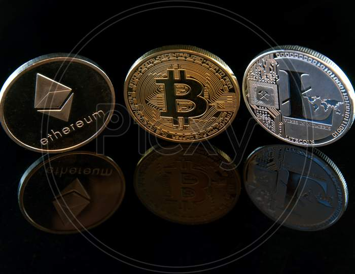 cryptocurrencies concept coins on black with reflections concept abstract