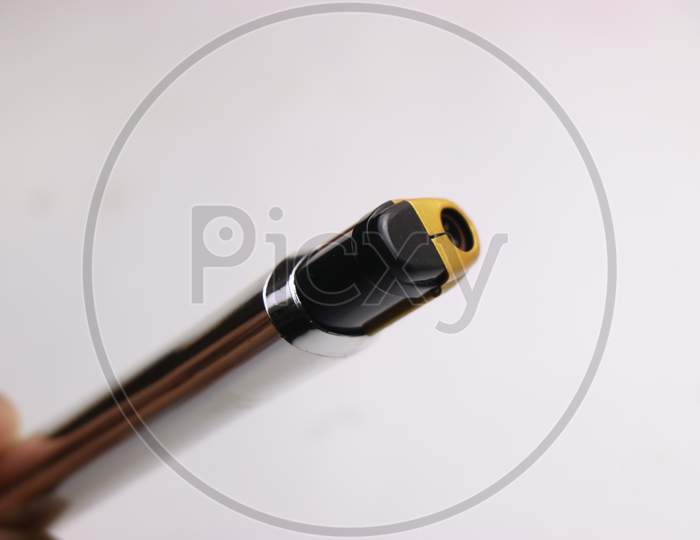 Cigarette Lighter Which Is Used To Light Cigarettes On White Background