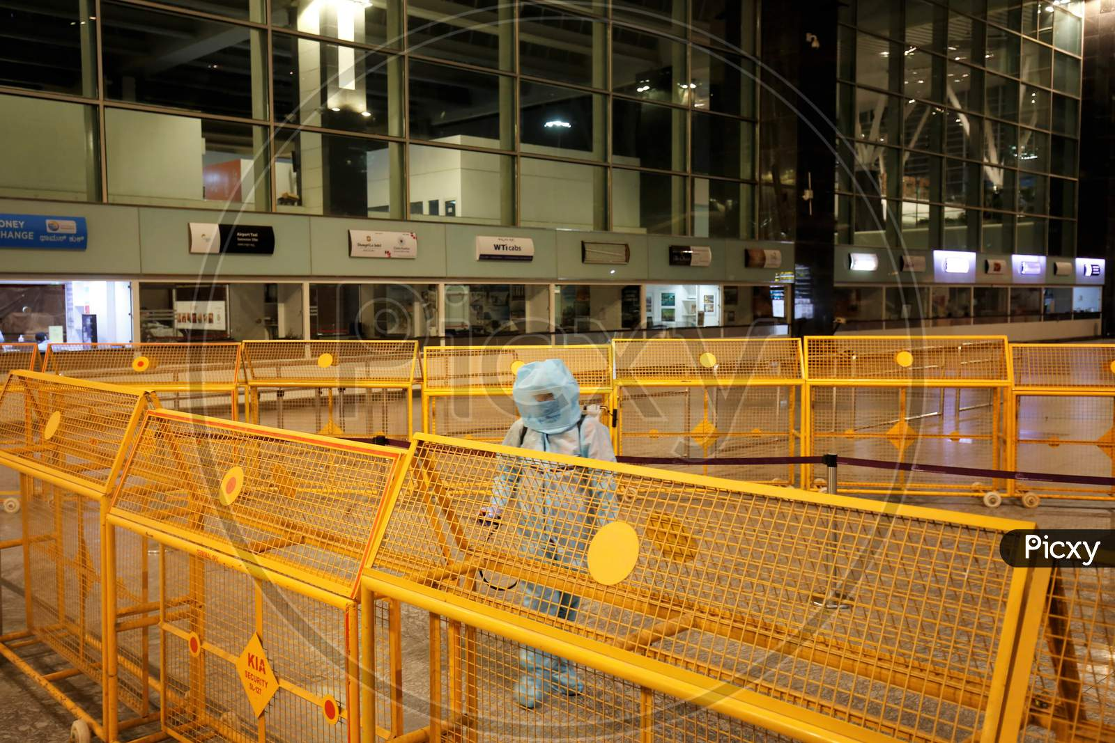 An Airport Worker Sprays Disinfectant At The Kempegowda International Airport In Bangalore, India, May 11, 2020. Three Hundred Twenty Six Passengers Stranded In The Uk Due To The Covid-19 Lockdown Arrived In An Air India Flight At The Break Of Dawn.