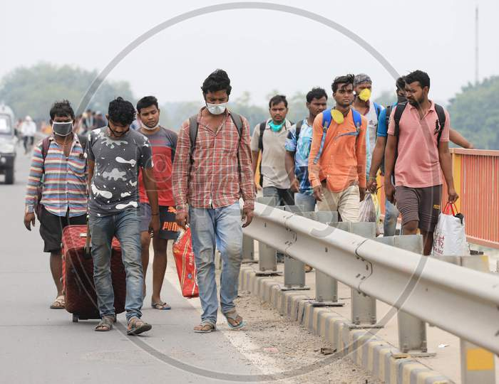 Migrant Workers Walking Along Highway Roads Carrying Belongings on Their Heads To reach Their Native Towns During Nationwide Lockdown Amidst Coronavirus Or COVID-19 Pandemic In Prayagraj, May 12, 2020.