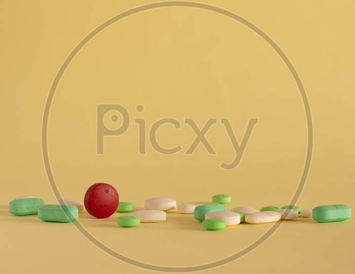 Medicines On A Neutral Yellow Background. Drugs For Legal Use. Pharmaceutical Industry. Concept Of Medication Abuse. Medicines For Medicinal Use. Copy Space