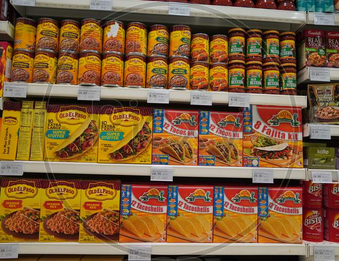 Assorted A Packed Of Taco Shells Display For Sale In The Supermarket Shelves. Also Present Salsa Bottles. Hard Shell Corn Taco Shells Boxes.
