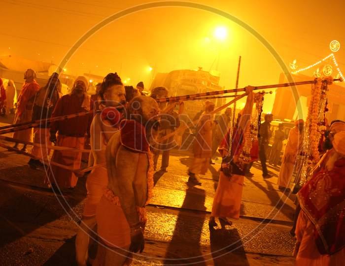 """A Naga sadhu or a Hindu holy man stands during the """"Shahi Snan"""" (grand bath) at """"Kumbh Mela"""" in Allahabad, Uttar Pradesh, India."""