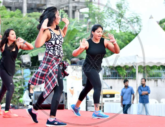 Zumba Dancers Performs Zumba During Marathon Warmup Session,Corporate yoga pose