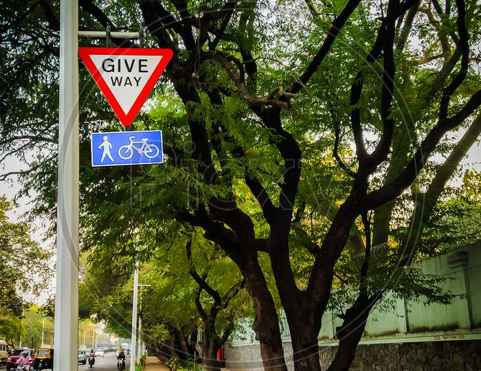 Give Way For Pedestrians And Cycle Sign Board In Urban City Of India