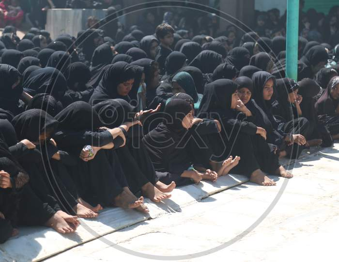 Shiite Muslim mourners flagellating themselves during a procession on the tenth day of Muharram which marks the day of Ashura in Ajmer, India.