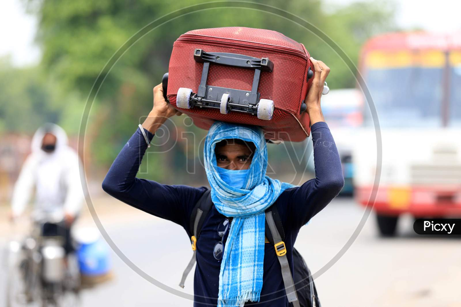 A Migrant Worker Walks To Reach Their Native Places During Nationwide Lockdown Amidst Coronavirus Or Covid-19 Pandemic In Prayagraj