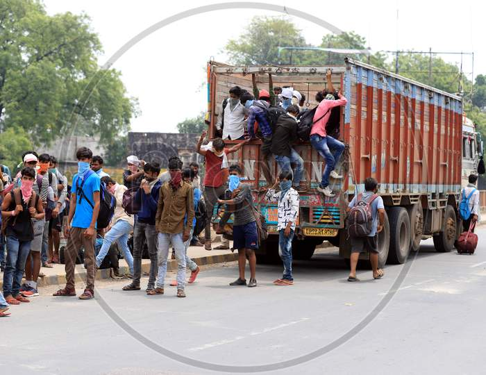 Migrant Workers Board A Truck To Reach Their Native Places During Nationwide Lockdown Amidst Coronavirus Or Covid-19 Pandemic In Prayagraj