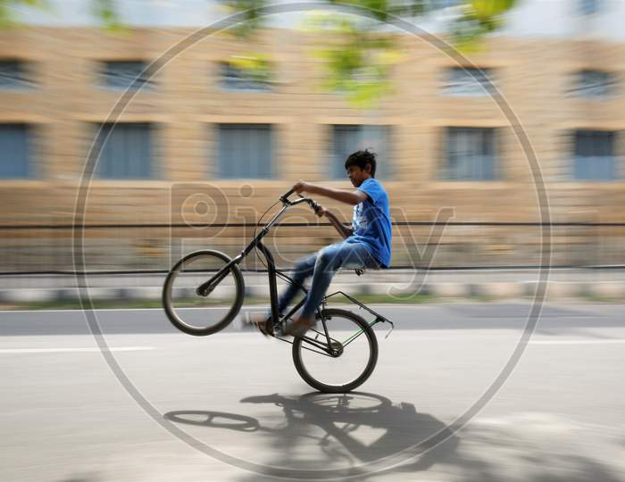 A boy rides a bicycle on an empty street during the nationwide lockdown to stop the spread of coronavirus (Covid-19) in Bangalore, India.