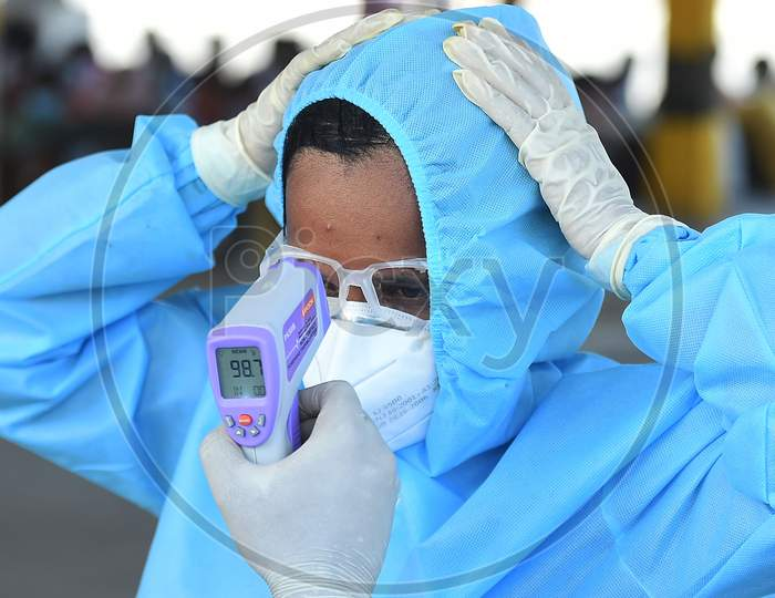 Health Workers Conducting The Thermal Screening During The Ongoing Nationwide Lockdown In The Wake Of Coronavirus Pandemic, In Chennai