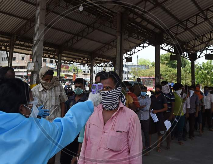 Migrant Labourers From Bihar Get Thermal Screening And Document Verification Before They Leave To Them Native Places During The Ongoing Nationwide Lockdown In The Wake Of Coronavirus Pandemic, In Chennai