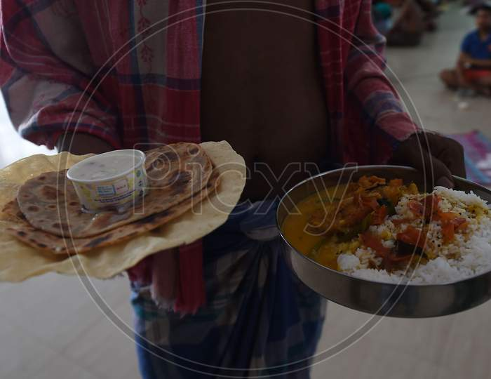 Migrant Workers Eat At Their Camp During A Government-Imposed Nationwide Lockdown As A Preventive Measure Against The Covid-19 Coronavirus, In Chennai.