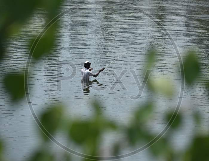 A Local Catches Fish At The Rivas Canal During The Nationwide Lockdown Amid Coronavirus Pandemic In Vijayawada.