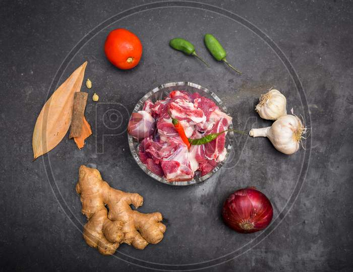 Chopped raw meat on black background , top view . raw Lamb and mutton meat isolated.