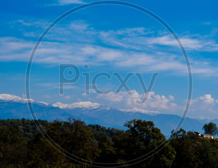 himalayan mountain range covered with the snow at patnitop a city of Jammu, Winter landscape