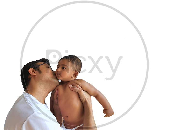 A Father In Glasses Kissing A Little Boy On His Lap In White Background