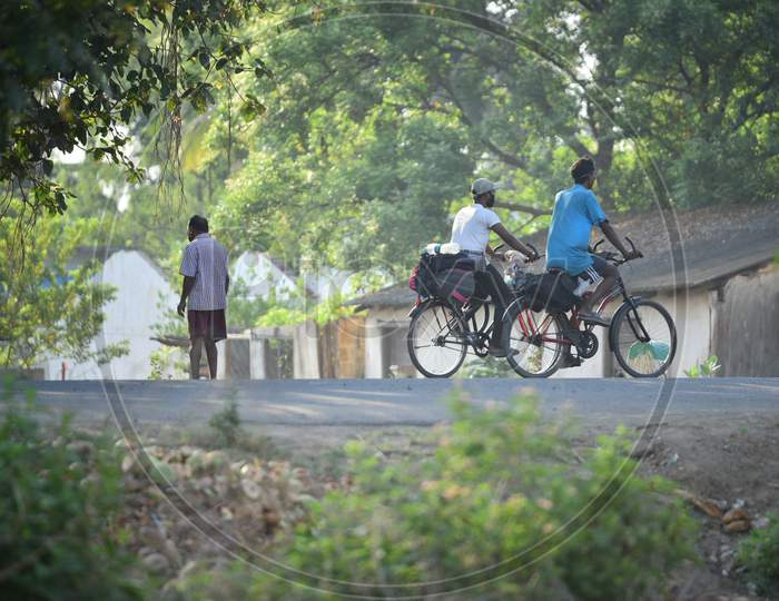 Migrant Workers seen cycling at Telangana State Border in Aswaraopet in a bid to reach their hometowns in West Bengal and Bihar