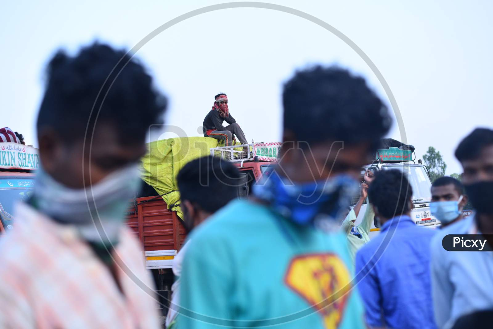 A Migrant Worker Sits On A Lorry As He Waits For Clearance Permission To Cross The Ts-Ap Border At Aswaraopeta,Telangana,May 16,2020