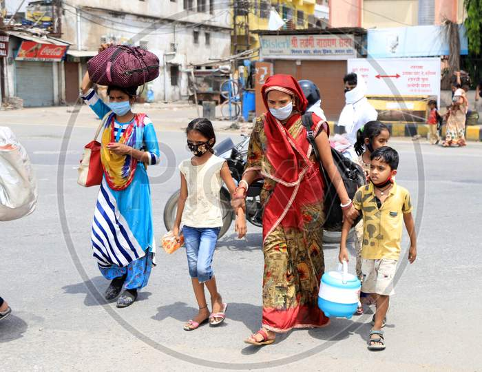Migrant Workers' Family Walking On roads Carrying Luggage To Their Native Places During Extended Nationwide Lockdown Amidst Coronavirus Or COVID-19 Pandemic in Prayagraj