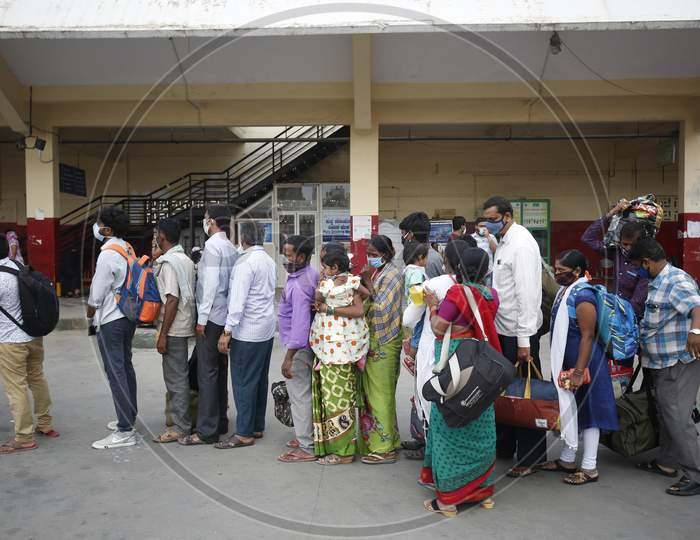 People wait in queue to board a public transport bus after the state eased lockdown norms during the nationwide lockdown to prevent the spread of coronavirus (COVID-19) in Bangalore, India.