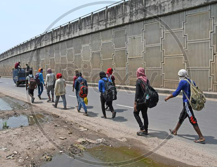 Migrant workers stranded due to lockdown in the emergence of Novel Coronavirus (COVID-19) are walking from Barrackpore (West Bengal) to Bihar on their own initiative. Migrant workers are walking on the 2 no National Highway towards their destination. At Burdwan Town.