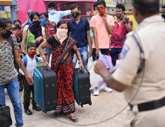 Migrant Workers from Bihar, Jharkhand and UP board a bus after  registering from Cyberabad Police to get onto a Shramik Special Train during ongoing Nationwide Lockdown amid Coronavirus Pandemic, Kukatpally,Hyderabad, May 19,2020.