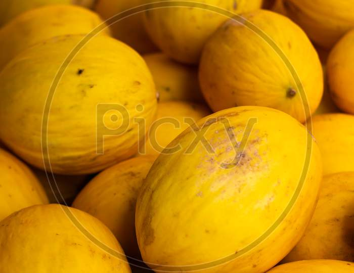 Yellow Rind Melons In The Market Fresh Fruit.