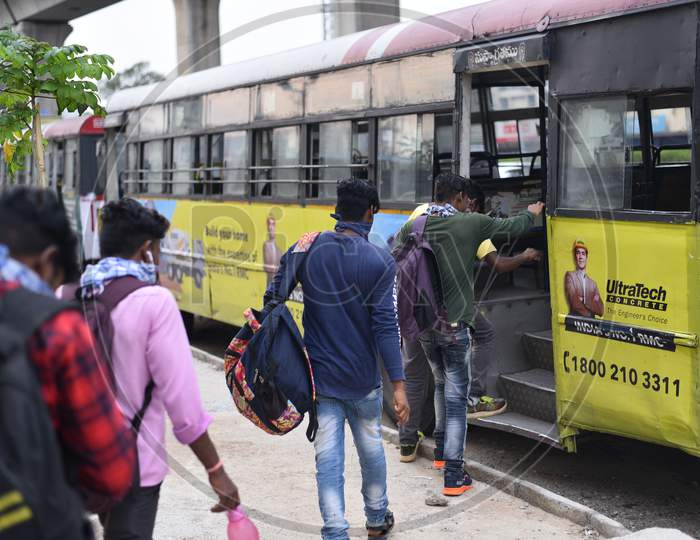 Migrant Workers from Bihar, Jharkhand and UP get into a bus after registering from Cyberabad Police to get onto a Shramik Special Train during ongoing Nationwide Lockdown amid Coronavirus Pandemic, Kukatpally,Hyderabad, May 19,2020.