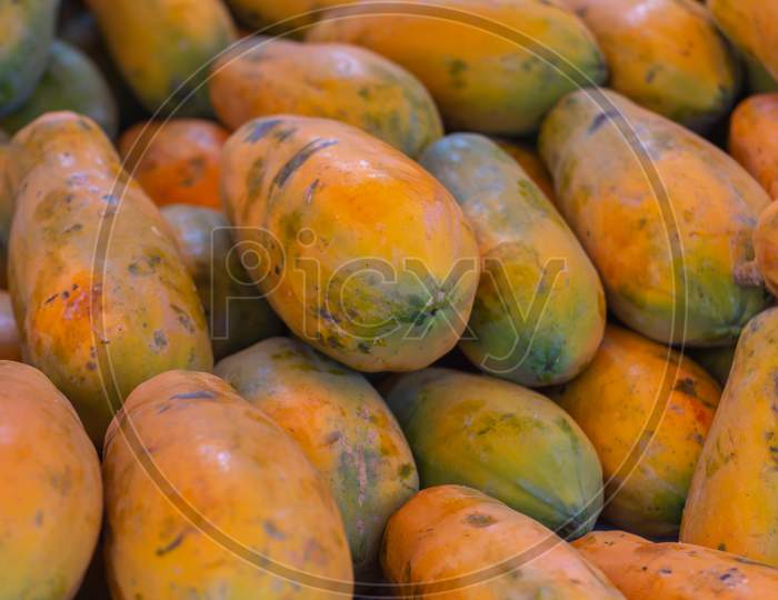 Papaya In The Market. Fruit Of Orange Pulp With Countless Small Seeds. Exotic Tropical Fruit
