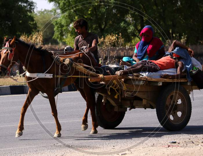 Migrants travel On a Horse Cart During Extended Nationwide Lockdown Amidst Coronavirus or COVID-19 Pandemic  In Ajmer On May 19, 2020