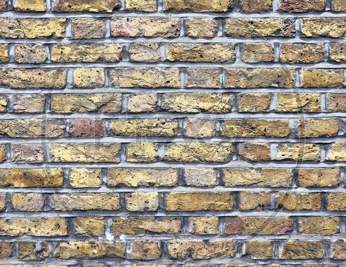 Colorful brick wall. Texture of old weathered historical brick wall panoramic background.