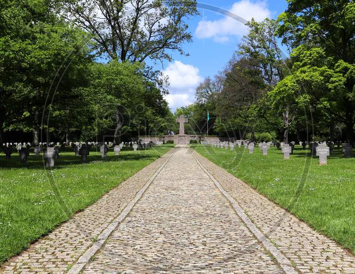 Sidewalk Leading To Cross At A Military Cemetery
