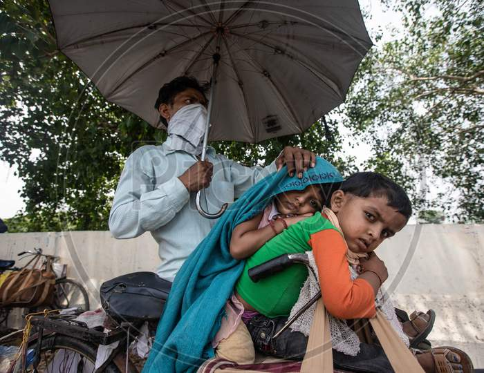 Migrant Worker Kamlesh  Peddling Back To His Village In Sagar District Of Madhya Pradesh With His Children Anushka 7, And Krishna, 4, In New Delhi, India, On May 11, 2020.Distance Between New Delhi To Sagar Is Approximately 680 Kilometres.