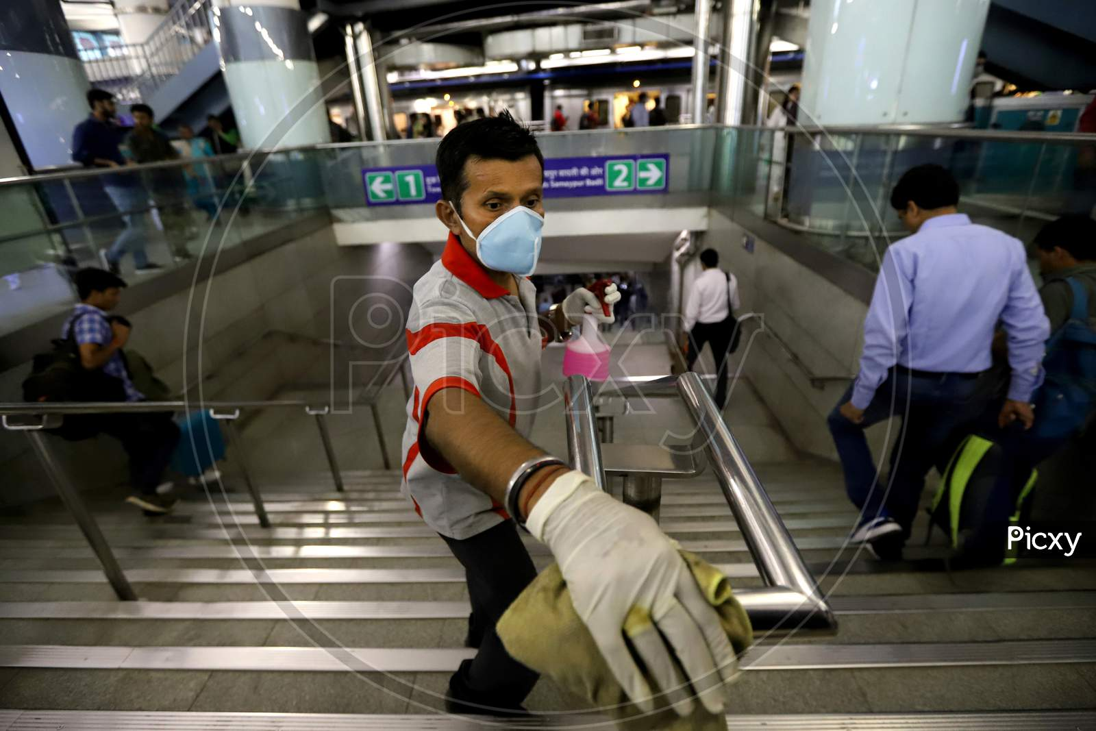 Delhi Metro Started Sanitation Drive As A Preventive Measure Against The Covid-19 Novel Coronavirus Walks Out Of A Metro Station In New Delhi On March 13, 2020.