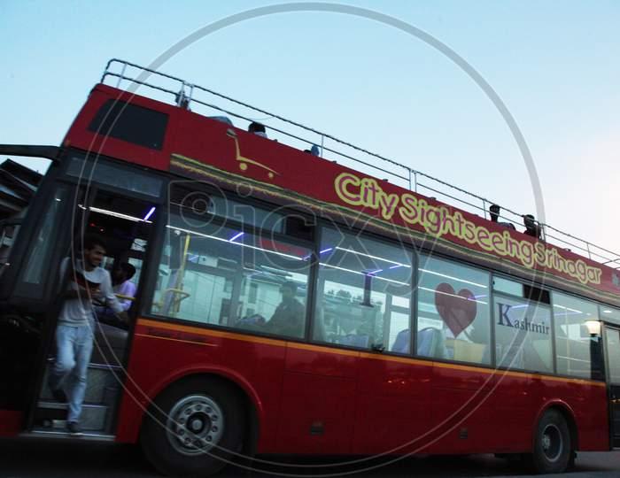 People moving in a double-decker bus in Kashmir