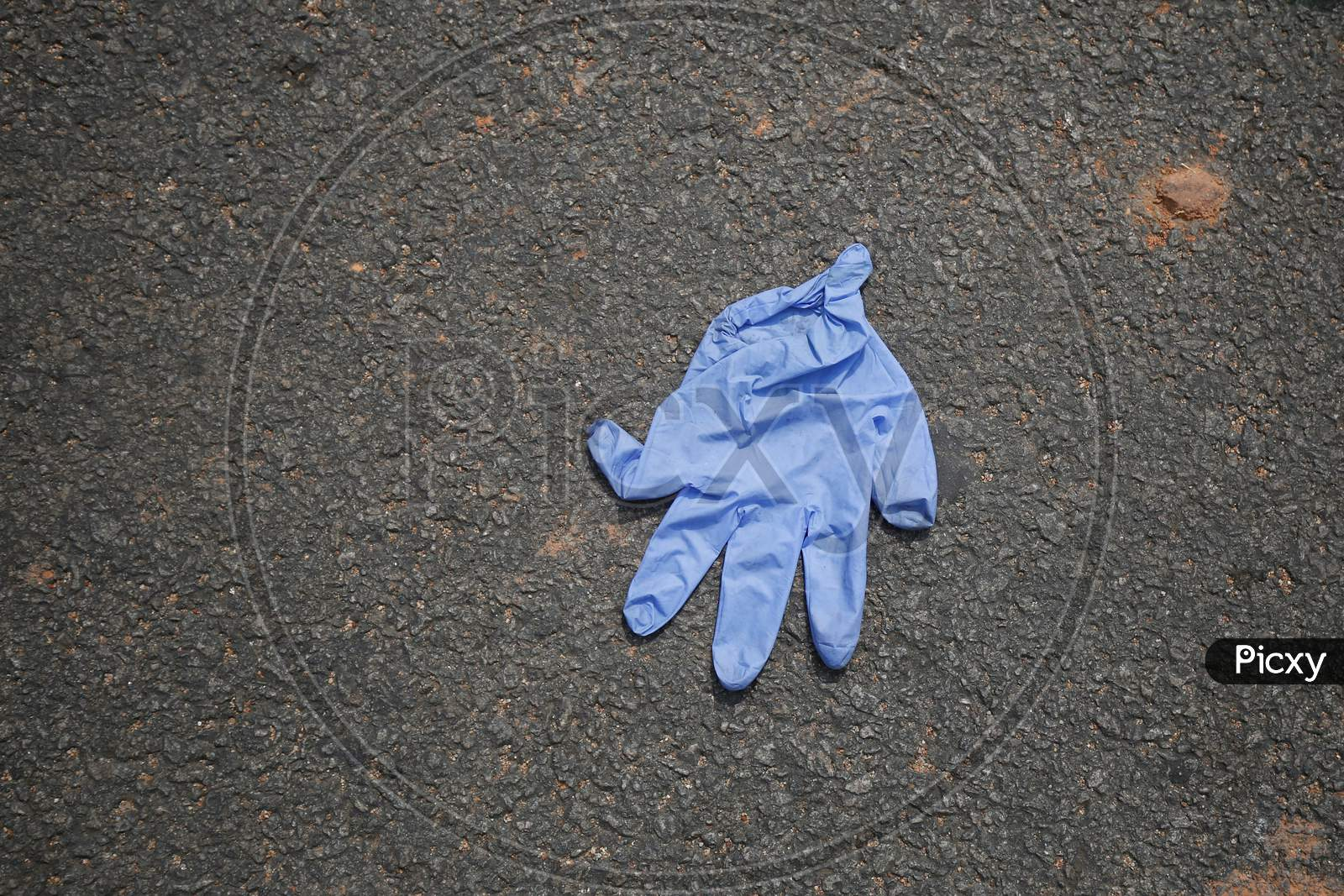 A discarded nitrile glove is seen on a road during the extended nationwide lockdown to prevent the spread of coronavirus (Covid-19) in Bangalore, India.