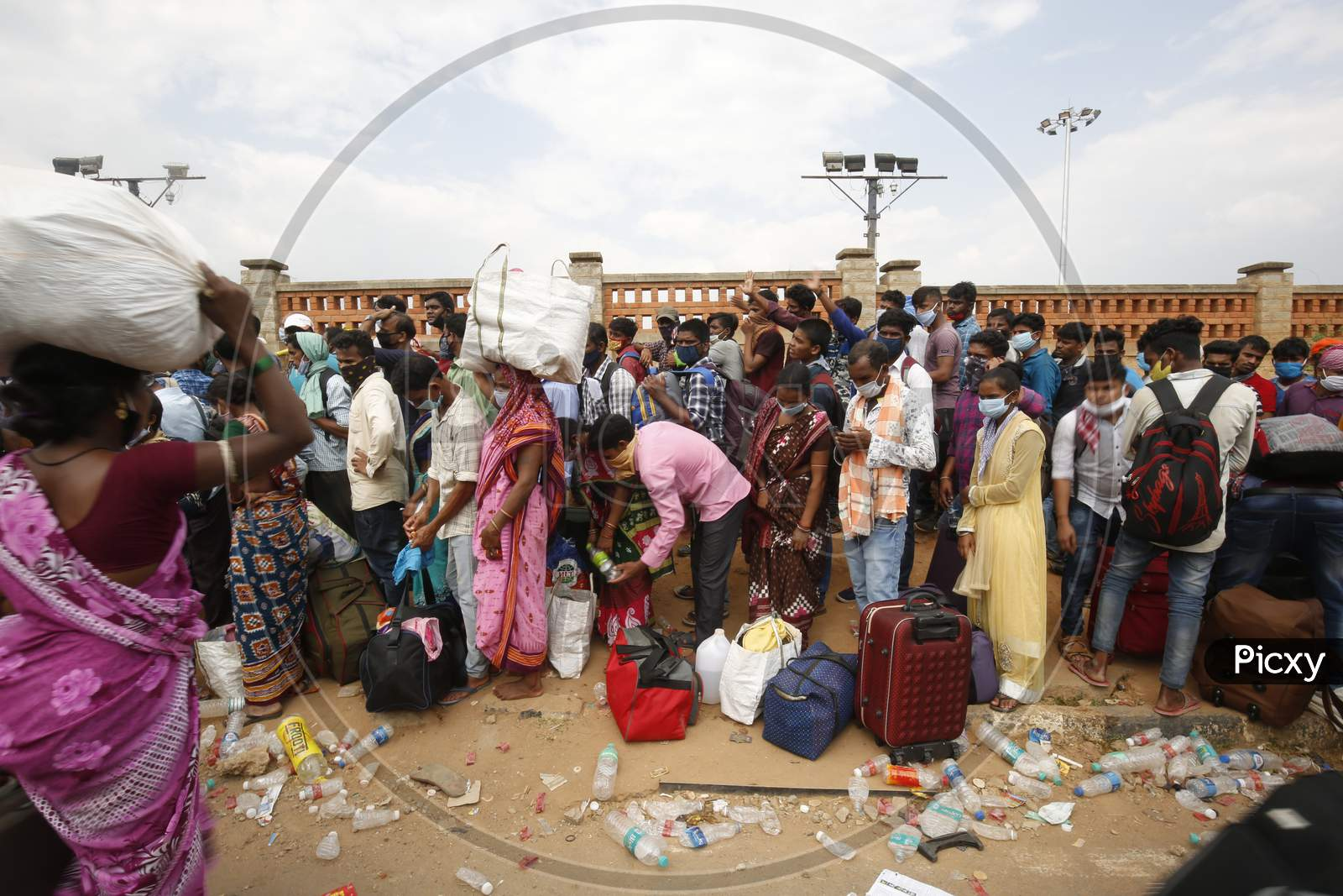 Migrant Workers From Odisha Wait For A Health Screening Before Boarding Buses To Be Taken To A Government-Arranged Train To Their Destination After The State Eased Lockdown Regulations During The Extended Nationwide Lockdown To Prevent The Spread Of Coronavirus (Covid-19) In Bangalore, India.