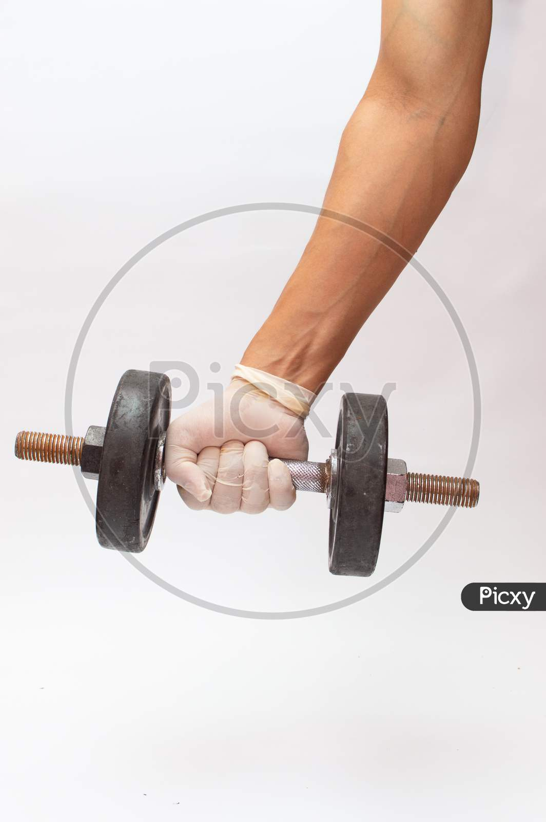 Dumbbell In A Hand Wearing Gloves