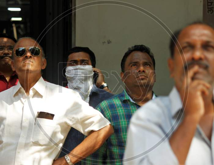 Men look at a screen (not pictured) displaying the Sensex results following the coronavirus outbreak on the facade of the Bombay Stock Exchange (BSE) building in Mumbai, India, March 12, 2020.