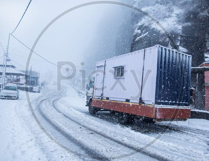 Truck On Dangerous Snowy Road,High Way. Moving In Winter Season, Bad Weather And Transportation Concept - Image