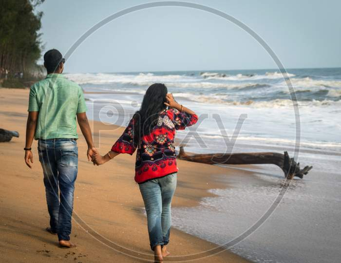 Couple Walking On Sandy Beach With Holding Each Others Hand And Soaking Up The Natural Sea View Image Is Taken At Kochi Kerala India Showing The Love And Affection Of The Couple In The True Nature.