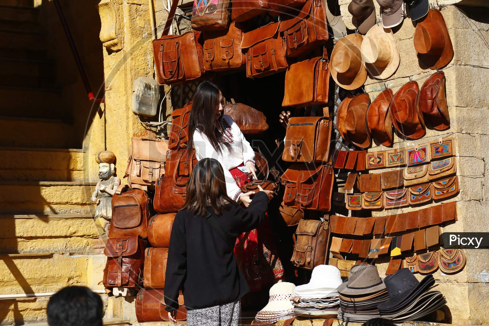 Image of Vendor Stalls With Hats And Caps At Jaisalmer Desert Festival,  Rajasthan, India-NP467457-Picxy