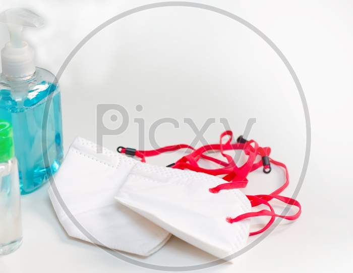 Corona virus prevention surgical masks, and hand sanitizer gel, liquid handwash soap for hand hygiene spread protection.