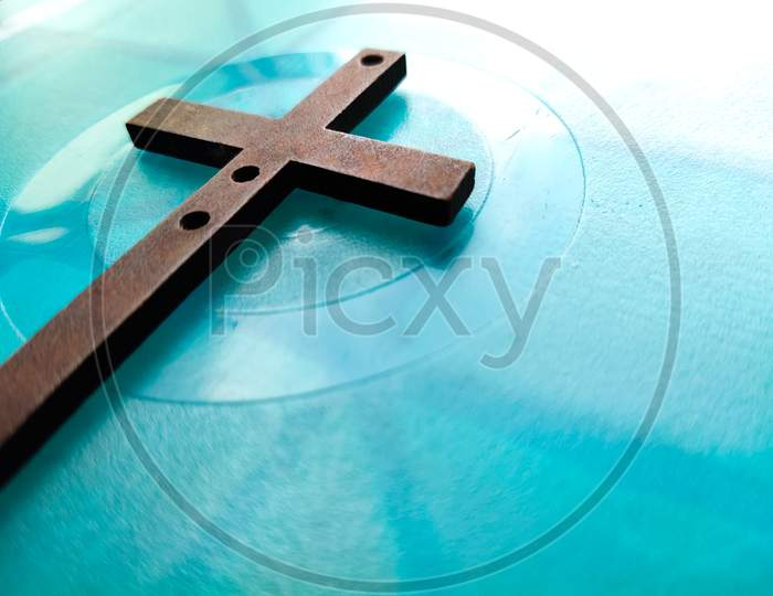 Image of wooden cross on blue background. Easter concept.